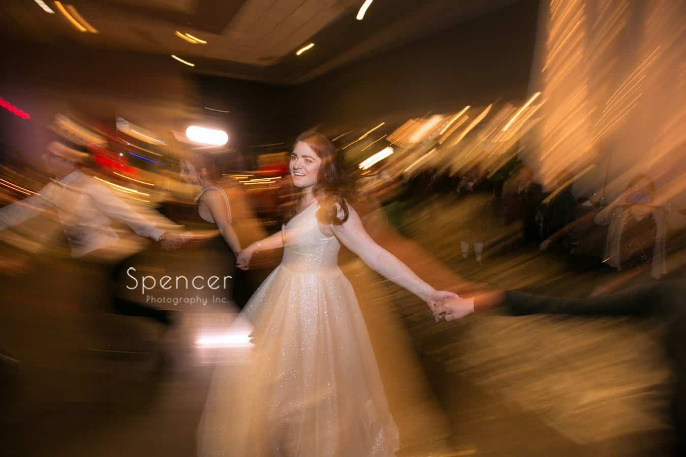 bride dances hora at landerhaven wedding reception