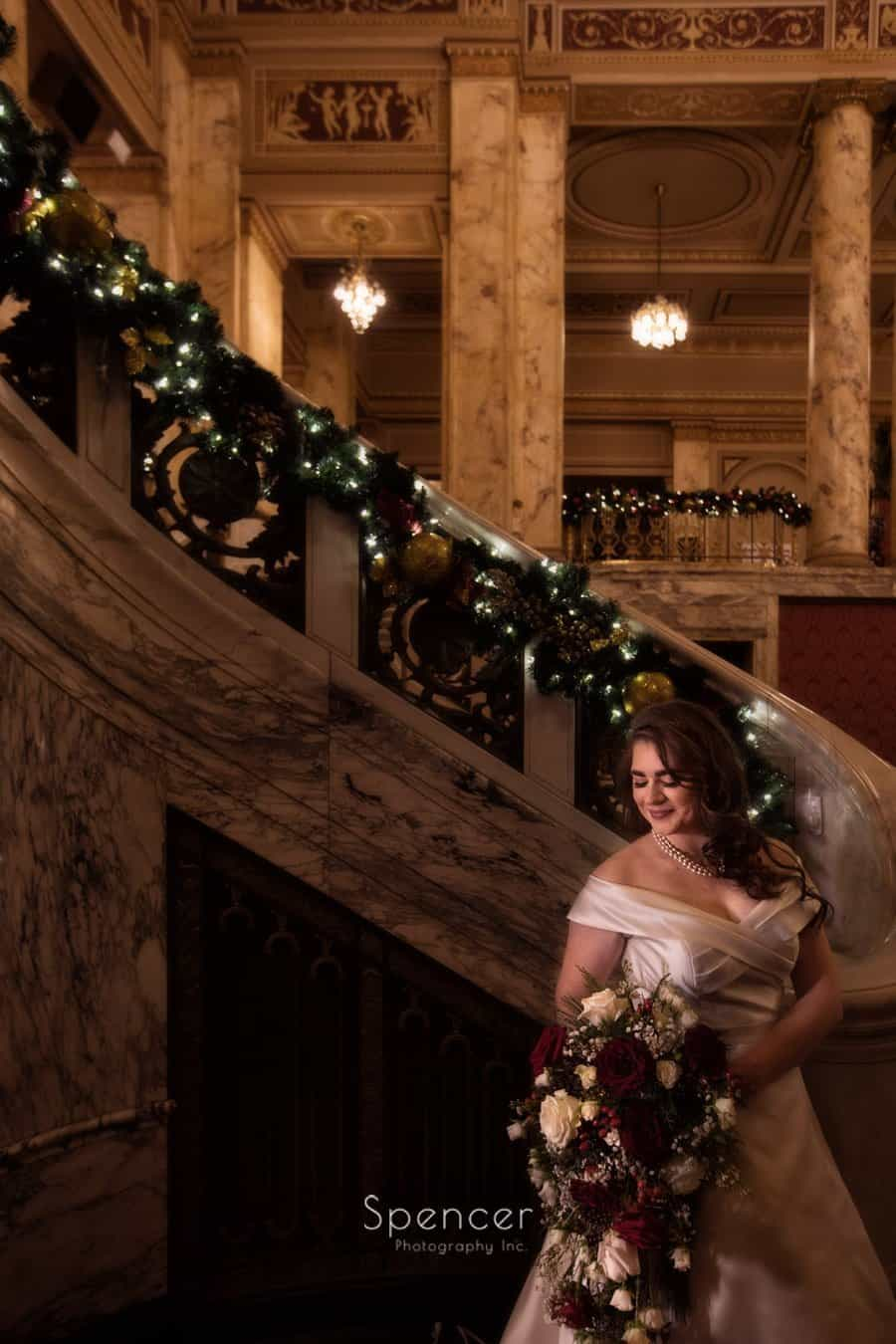 bride holding bouquet in christmas wedding pictures in Playhouse Square Cleveland