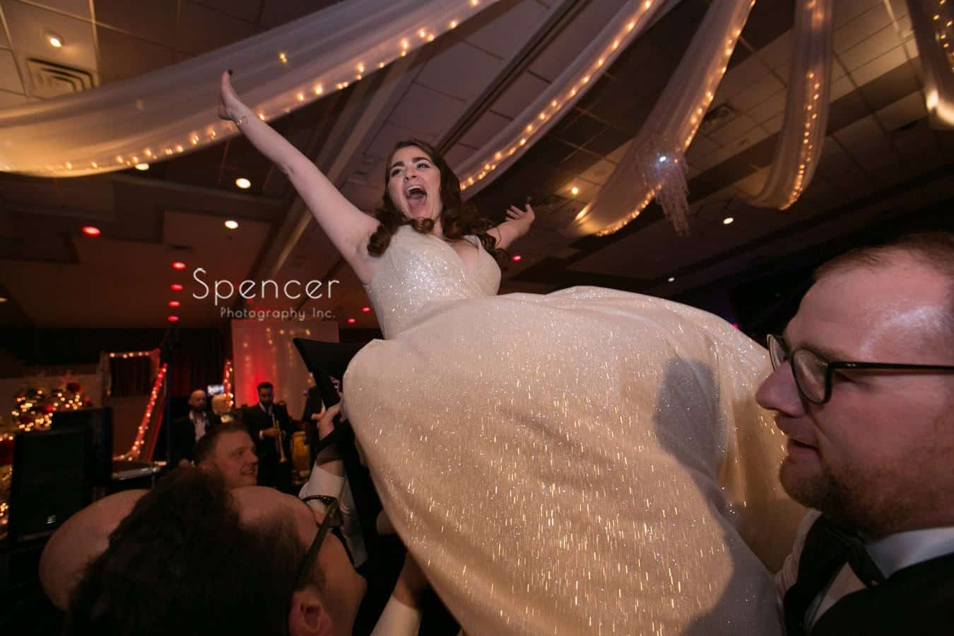 bride celebrates during hora at landerhaven