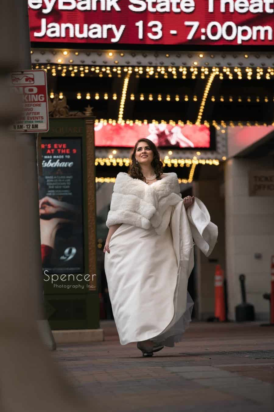 bride walking in playhouse square at christmastime