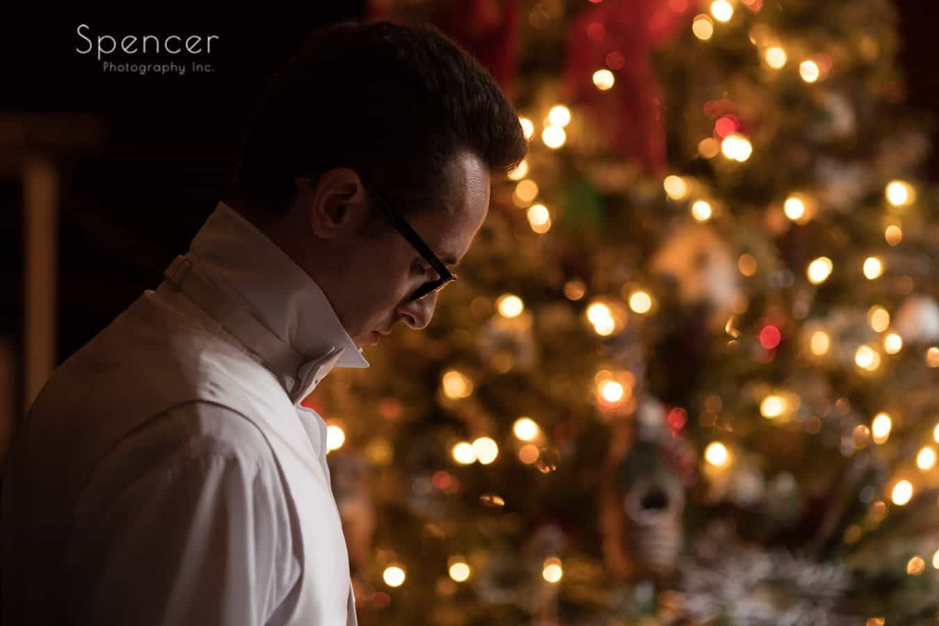groom prepping for his christmas wedding
