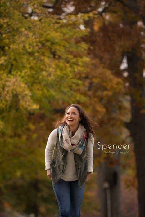 autumn senior picture with girl walking