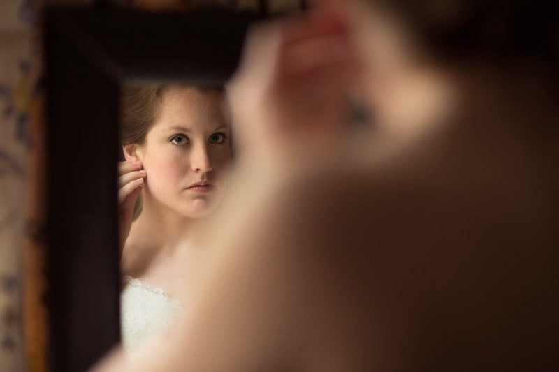 bride adjusting her earring