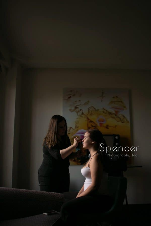 bride getting make-up applied at tudor arms cleveland