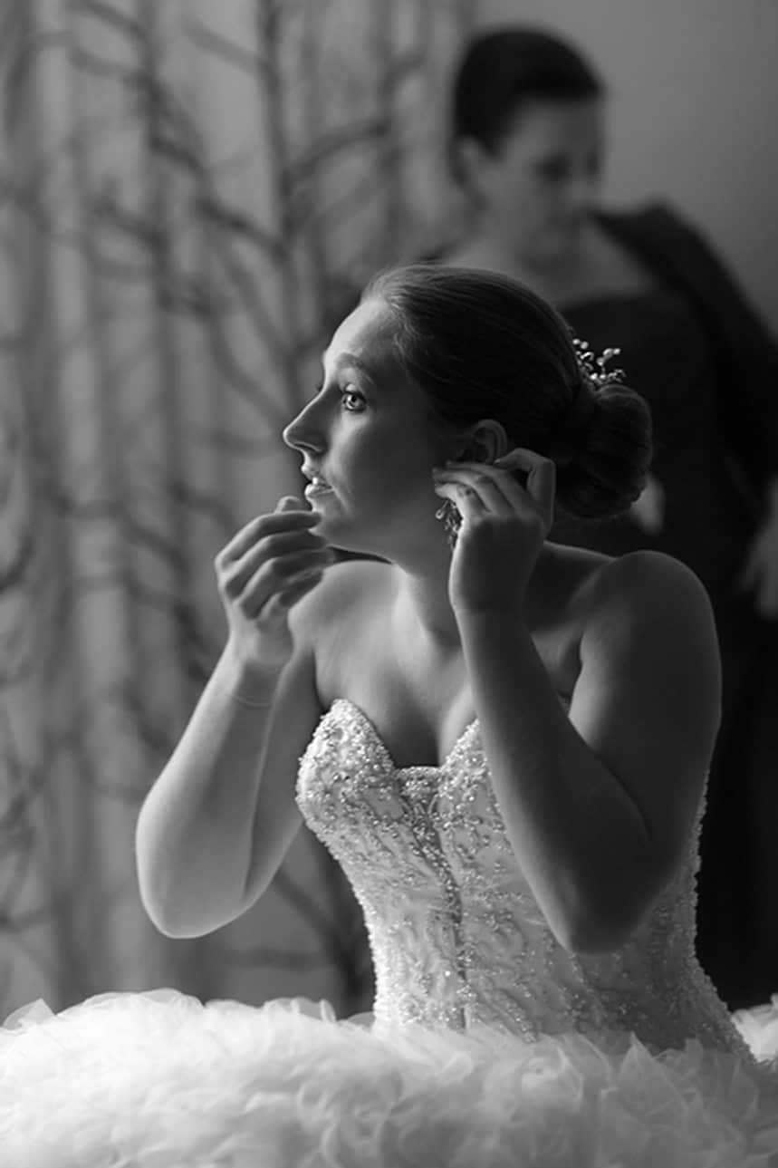 bride putting on earring before Cleveland wedding