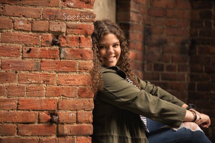 Senior Photos in Cleveland against brick wall