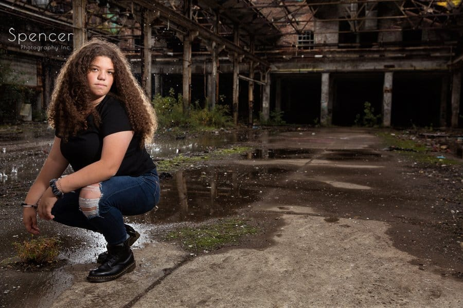 senior picture in old warehouse in Cleveland