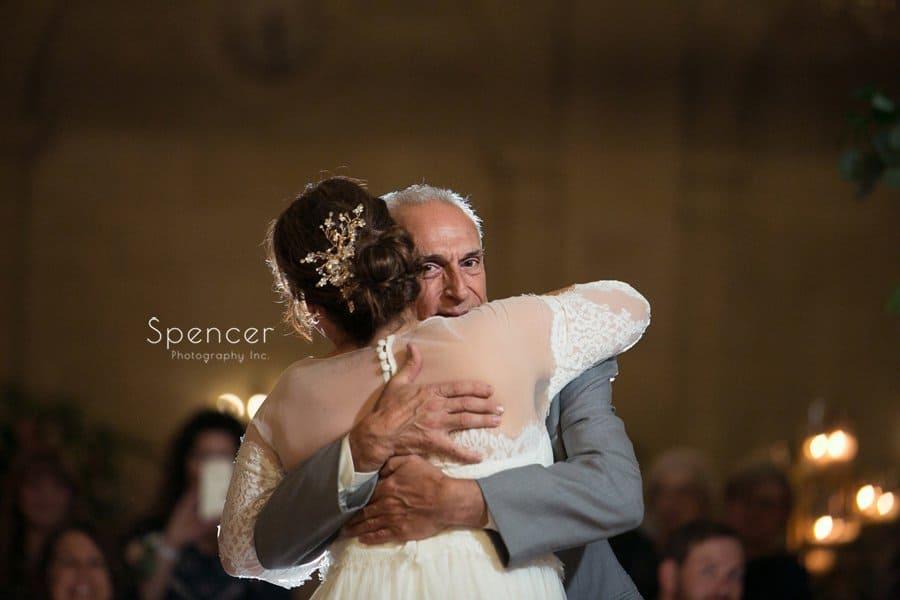 dad hugging bride at ariel pearl wedding reception