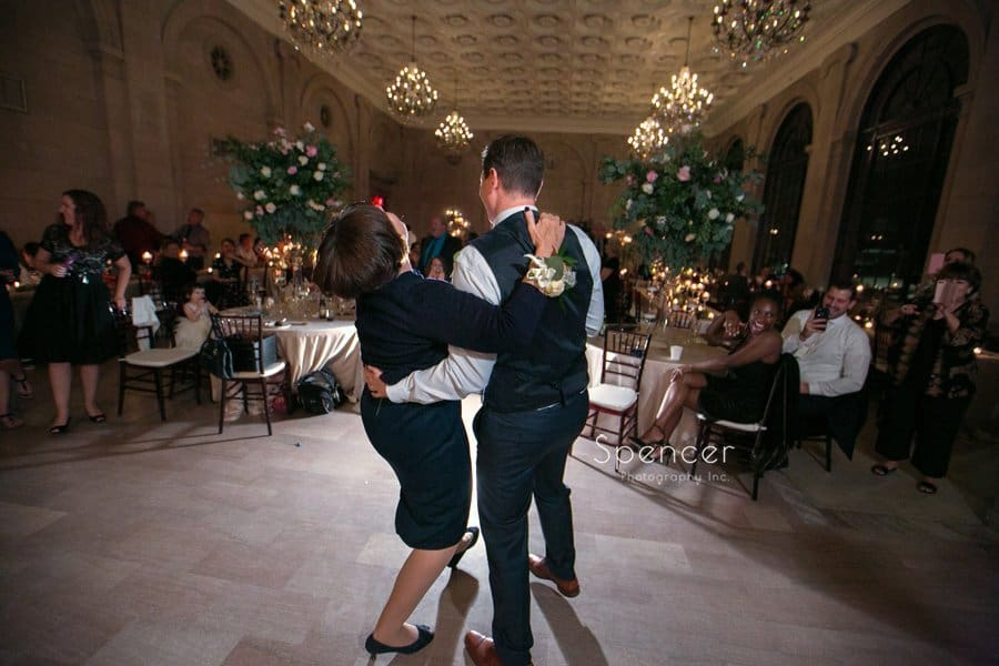 groom dancing with mom at wedding receptiona t ariel pearl