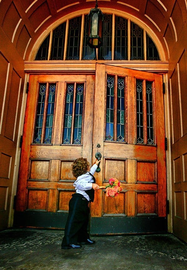 little boy taking bouquet into cleveland wedding ceremony