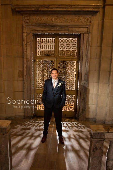 picture of groom in front of vault at ariel pearl
