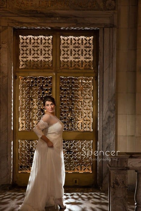 wedding picture of bride in front of vault at ariel pearl