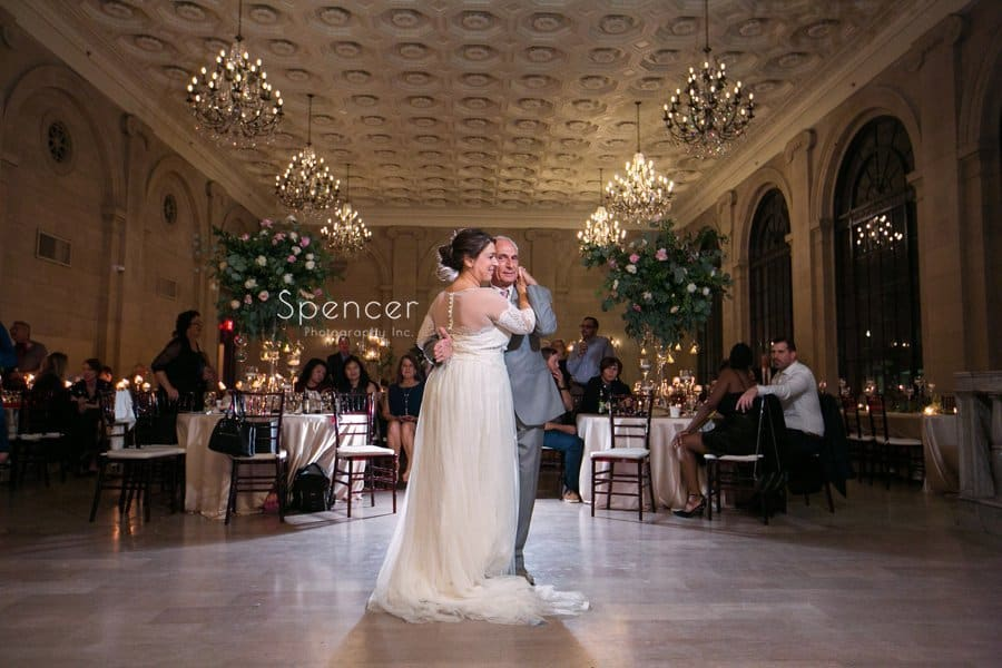 wide angle picture of bride dancing with dad at reception at ariel pearl