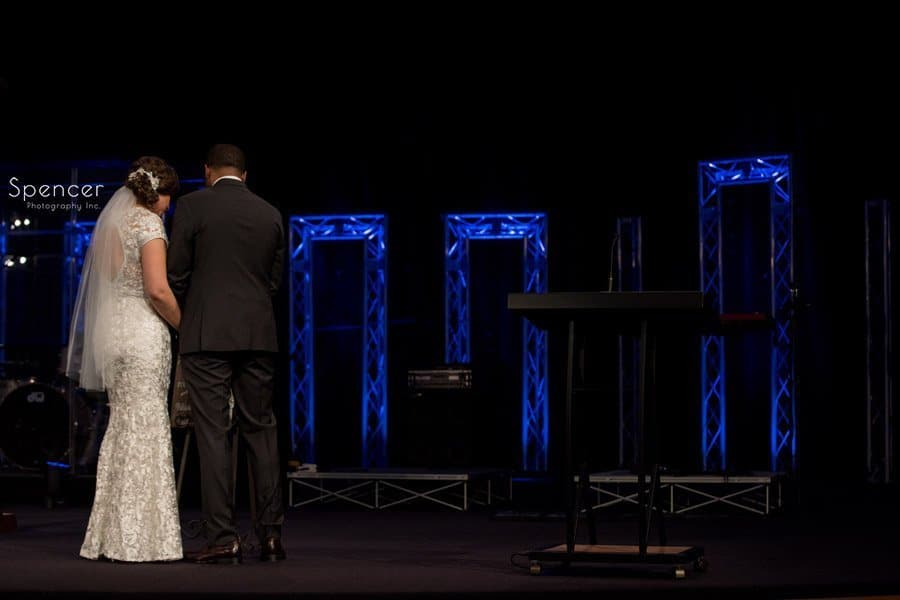 bride and groom share a moment during wedding cermeony