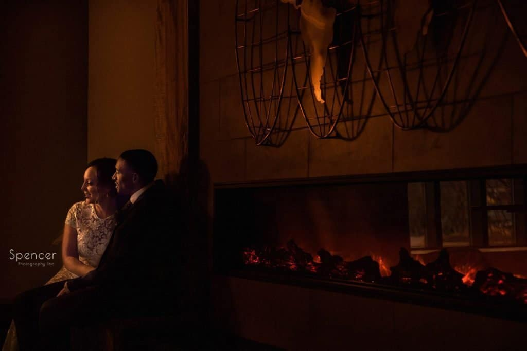 couple next to fireplace during winter wedding in Cleveland