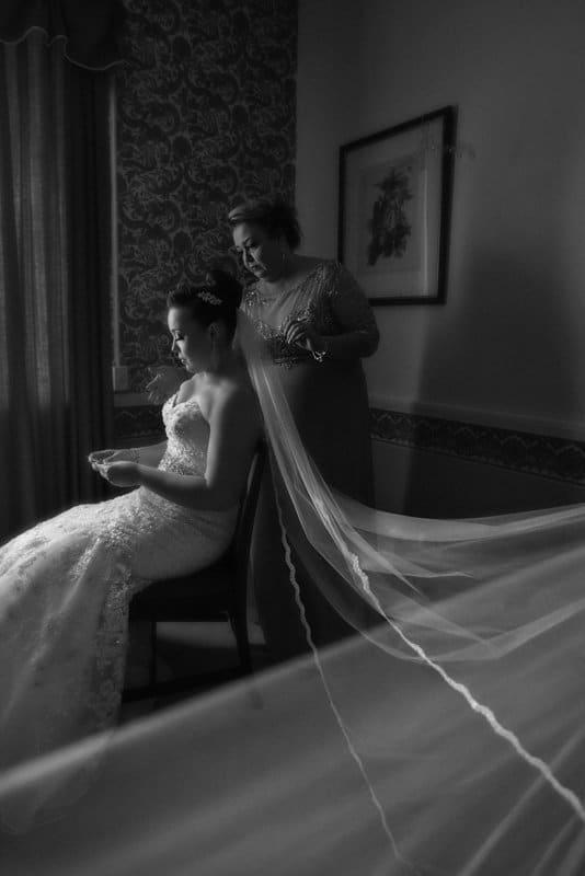 mom helping bride with veil before union club wedding