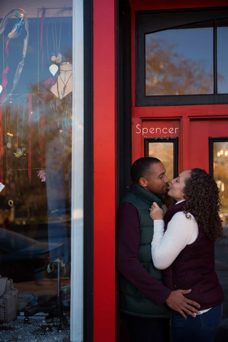 couple kissing in engagement pictures in Chagrin Falls