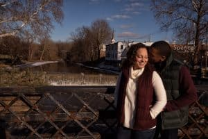 man kissing woman in engagement pictures in Chagrin Falls