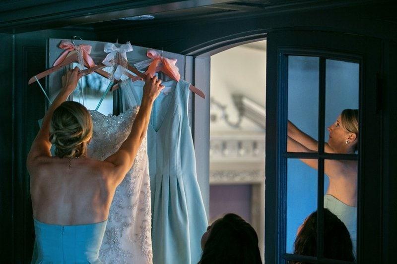 bridesmaid hanging wedding dress at Tudor Arms