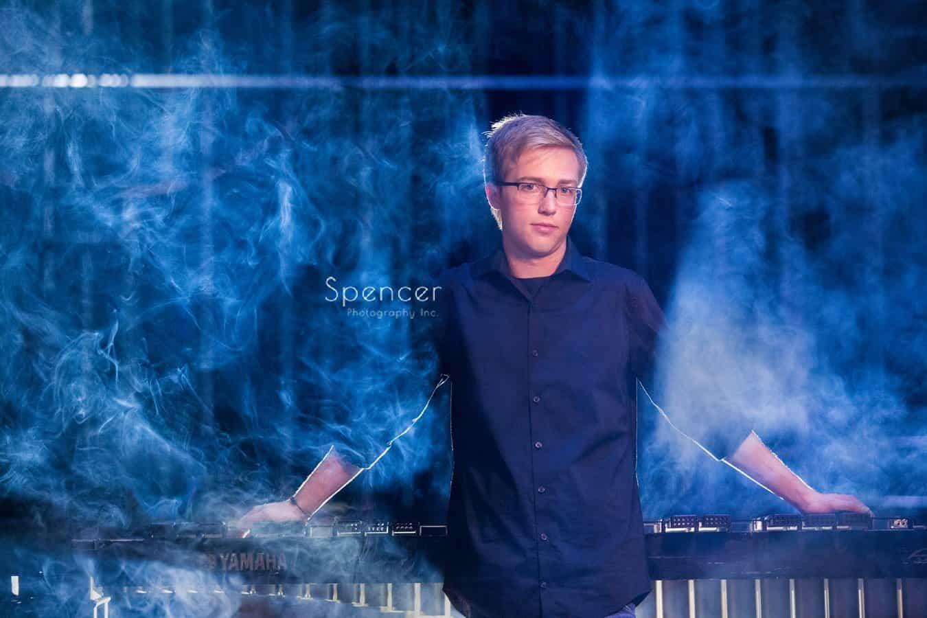 unique senior picture with smoke surrounding student