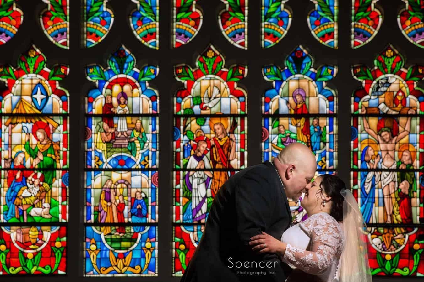 groom kissing bride in Lakewood United Methodist Church