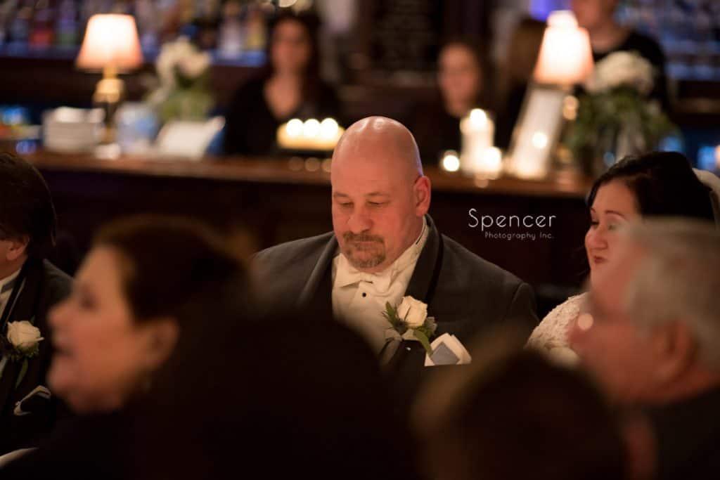 groom at his wedding reception at Vosh Nightclub