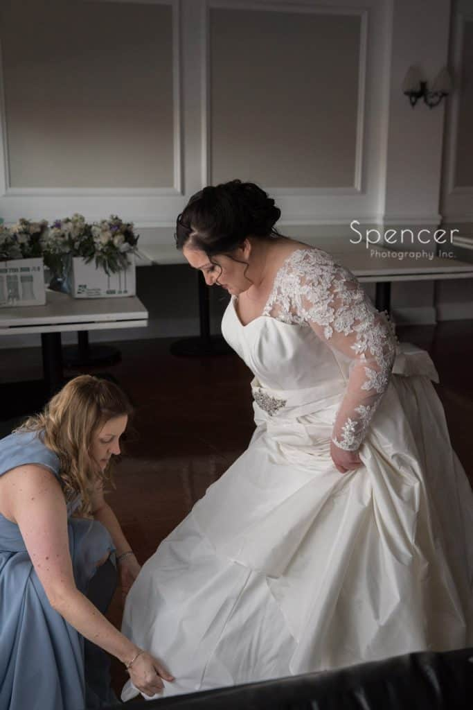 bride getting into wedding dress at Vosh Lakewood