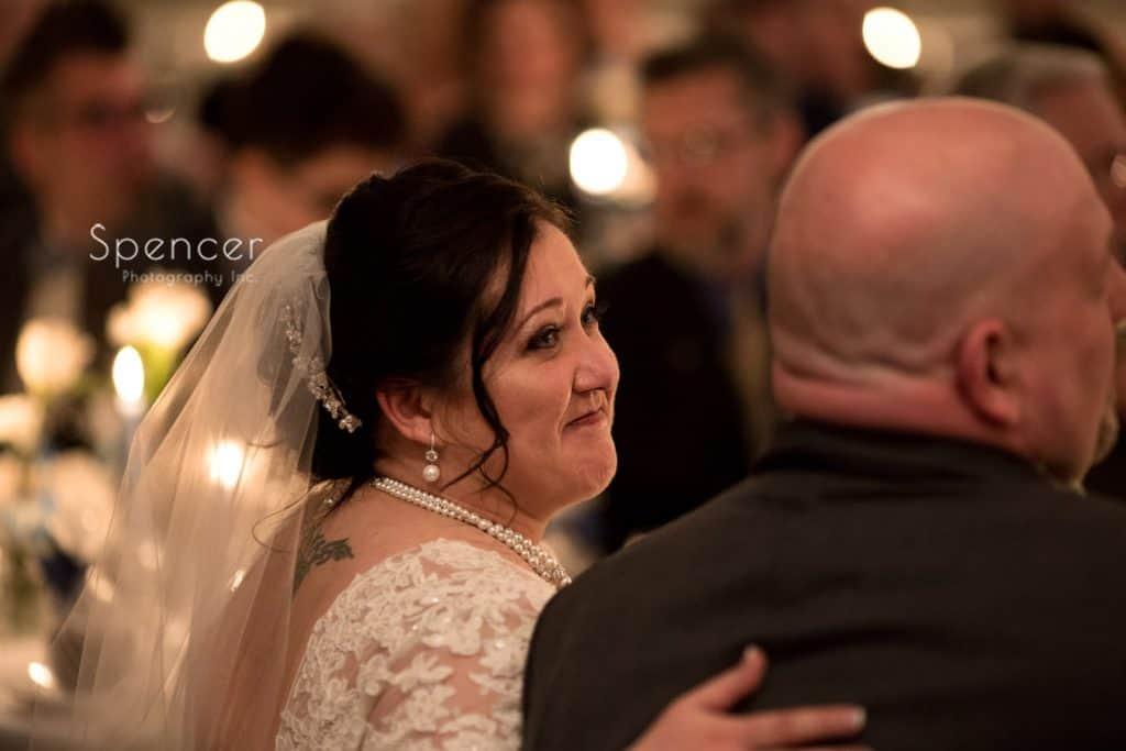 bride smiling at groom at Vosh wedding reception