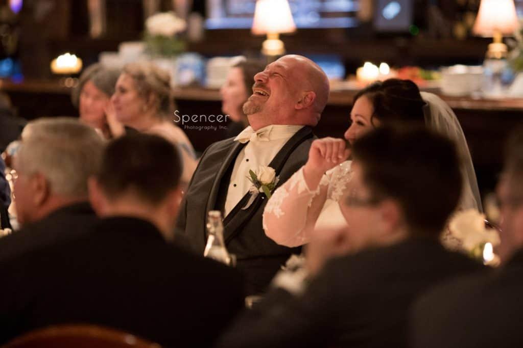 groom laughs during best man speech at Vosh Nightclub