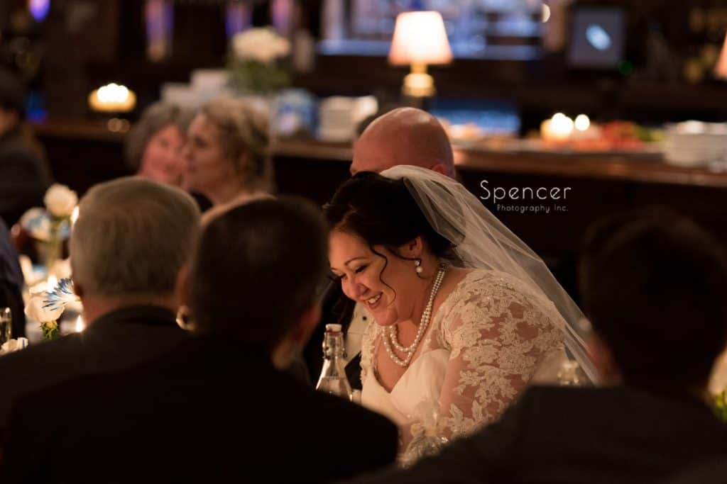 bride laughing during best man speech at Vosh reception