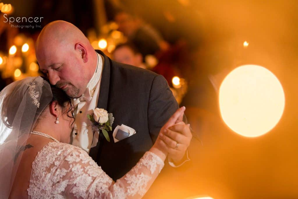 groom hugging bride during first dance at Vosh