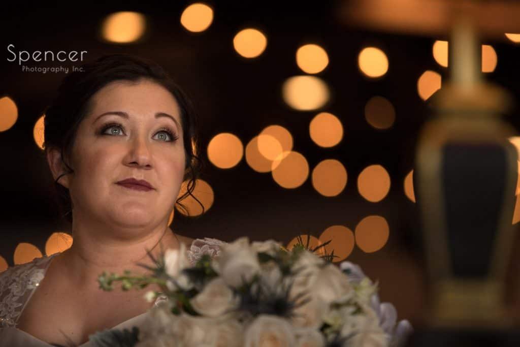 wedding portrait of bride in dining room of Vosh Lakewood