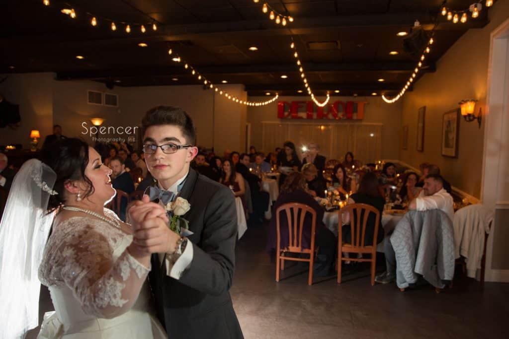 bride dances with son at Vosh wedding reception