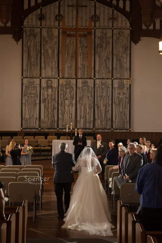 dad walking bride down aisle at Lakewood United Methodist Church
