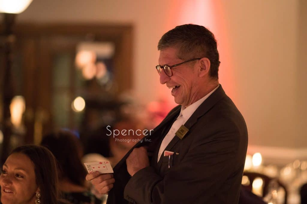 magician at Vosh reception laughing