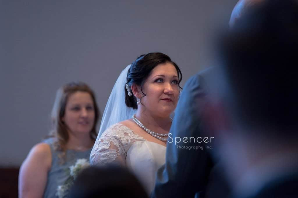 bride looking at groom during wedding ceremony