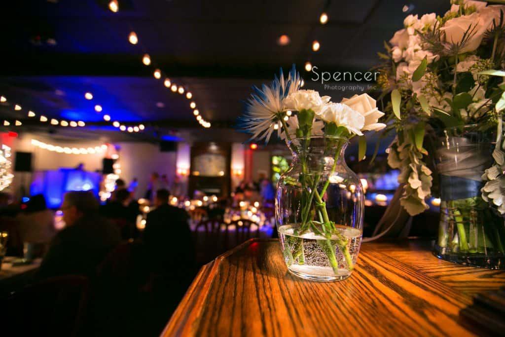 vase of flowers at wedding reception at Vosh Lakewood