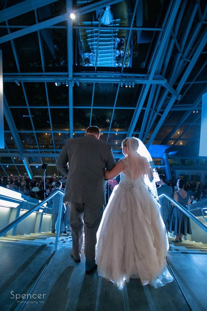 bride and groom enter wedding reception at akron art museum