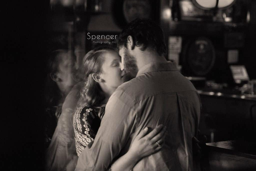 couple kissing during engagement pictures at Baxter's Bar Akron