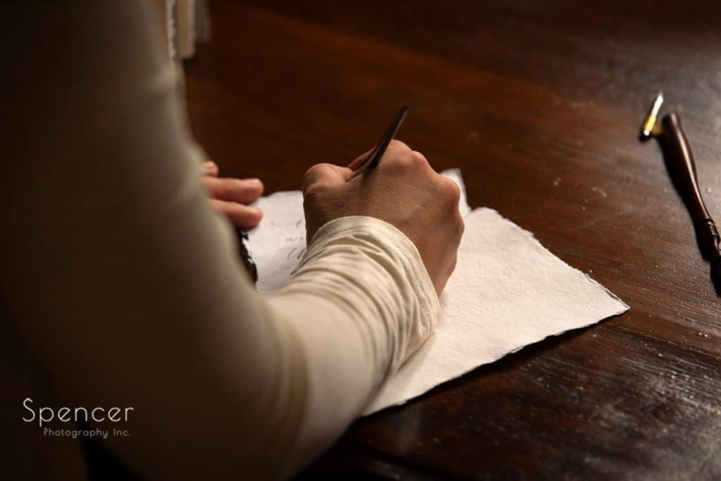 wedding calligrapher penning paper at O'Neil House Akron