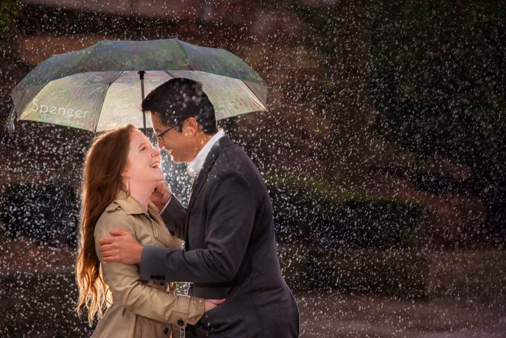 couple laughing in the rain during their engagement pictures at Cleveland Museum of Art