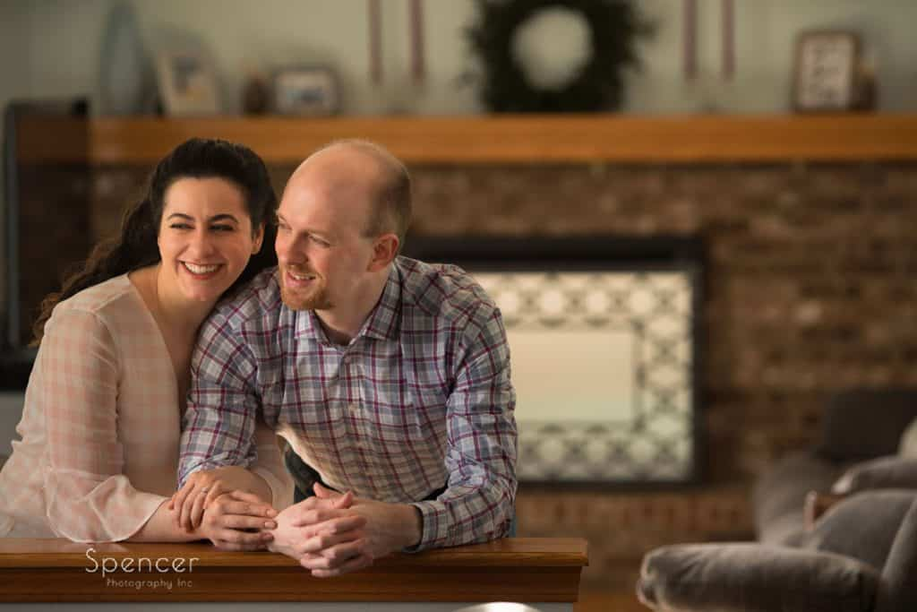 couple leaning in their engagement picgtures in Twinsburg