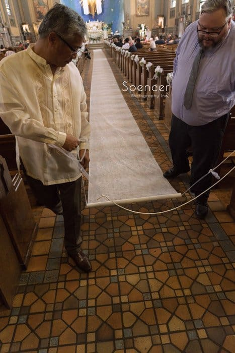 rolling our aisle running at wedding at Mary Queen of Peace Church Cleveland