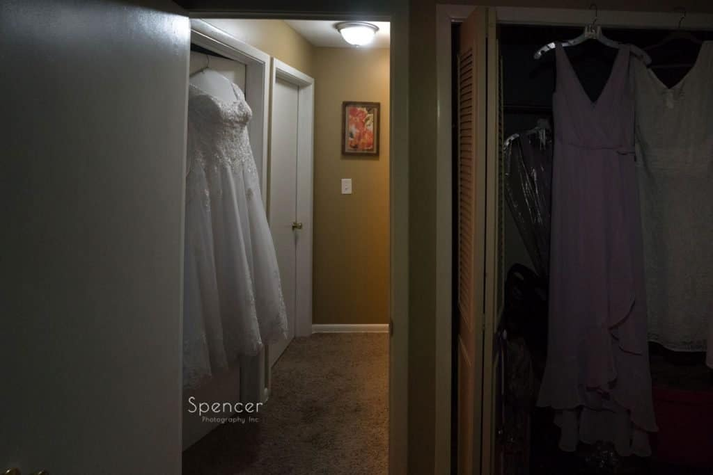 wedding dress hanging on door before Sunday wedding in Cleveland