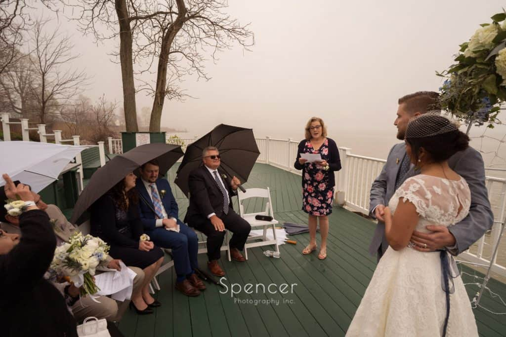 mother of groom sings at wedding ceremony