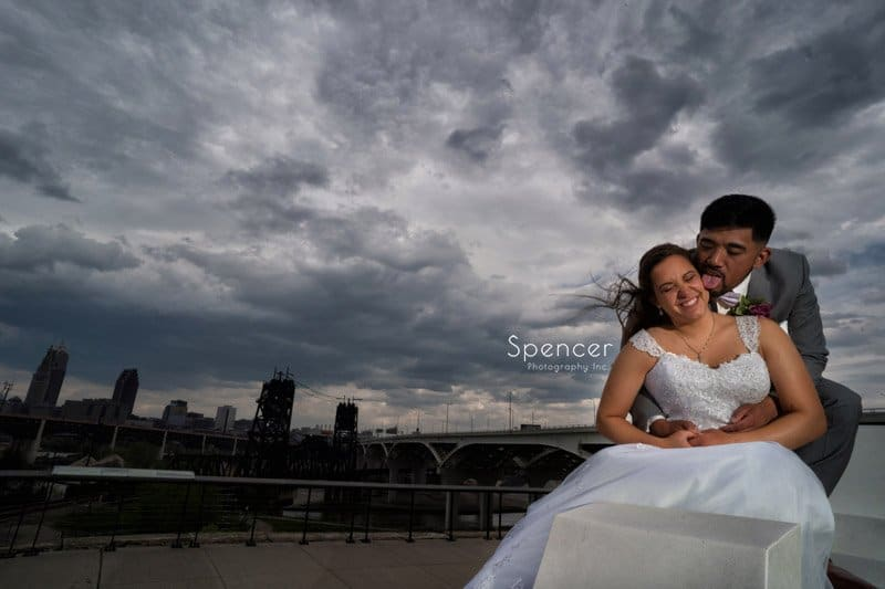 groom kissing bride in wedding picture Cleveland