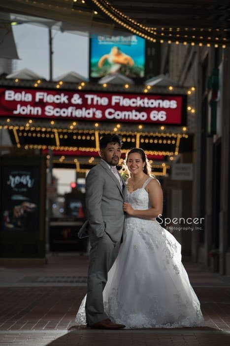 bride and groom standing in Playhouse Square