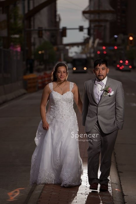bride and groom walking thru Playhouse Square Cleveland