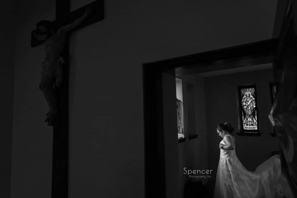 black and white picture of bride putting dress on in Cleveland