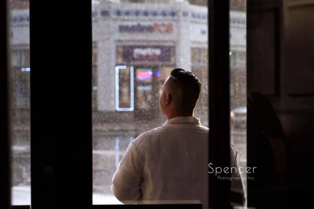 groomsmen standing in doorway at Ariel Pearl Cleveland